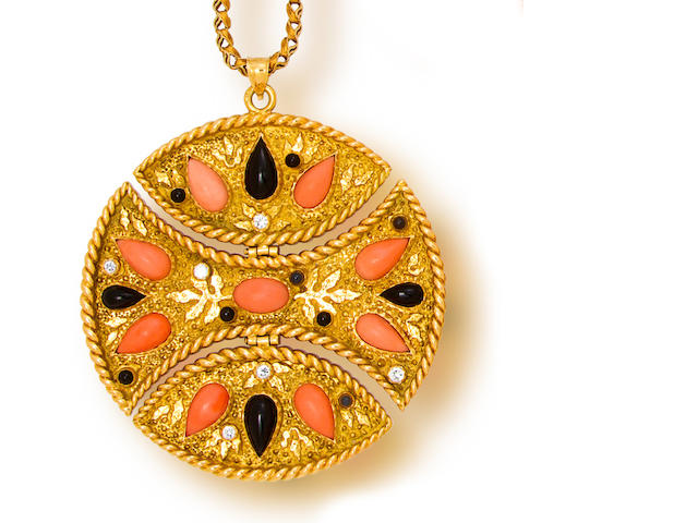 A coral, onyx, diamond and eighteen karat gold pendant, Van Cleef & Arpels, with fourteen karat gold chain