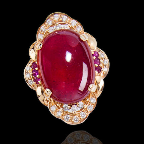 A ruby, diamond and fourteen karat gold ring