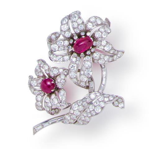 A diamond and ruby flower brooch