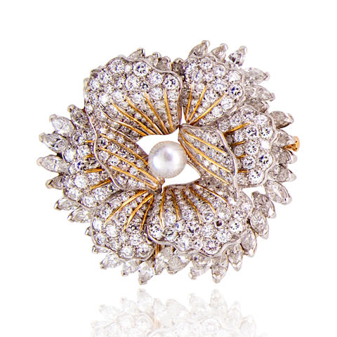A diamond and cultured pearl pendant/brooch,