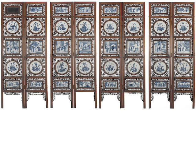 A large eight-panel mixed wood floor screen inset with blue and white plaques 19th century