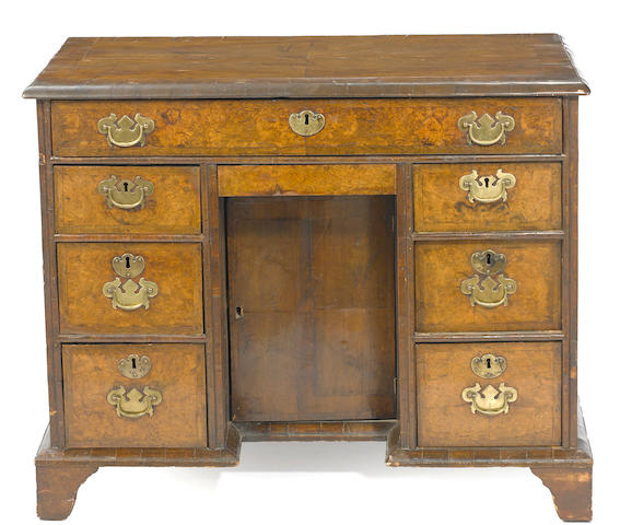 A George II walnut kneehole desk second quarter 18th century
