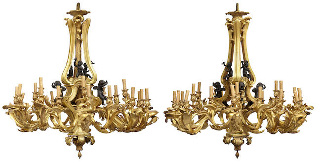 An impressive pair of Louis XV style gilt and patinated bronze twenty four light chandeliers in the manner of Jacques Caffieri (1678-1755) first half 20th century