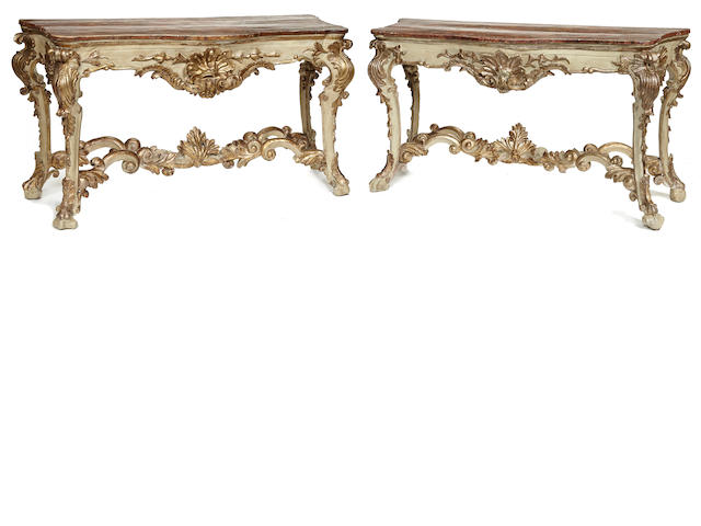 A fine pair of Venetian Rococo painted, parcel gilt and faux marble console tables third quarter 18th century