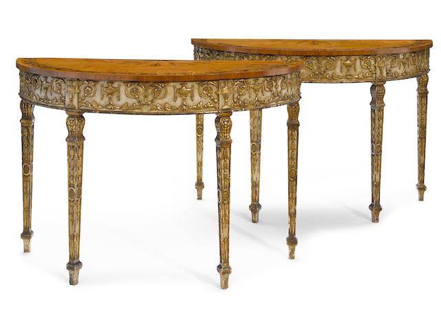 A pair of George III style parcel gilt paint decorated inlaid satinwood demilune tables