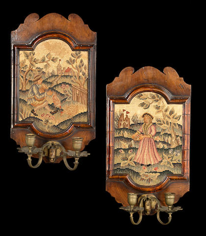 A pair of George II walnut needlepoint and brass two light girandoles  second quarter 18th century