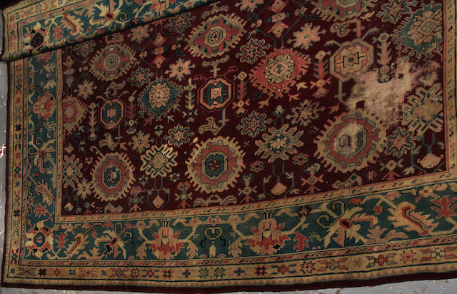 A Turkish carpet  size approximately 13ft. x 13ft. size approximately 13ft. x 13ft.