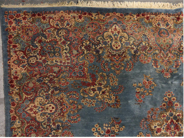 A Kerman carpet  size approximately 9ft. 7in. x 23ft.