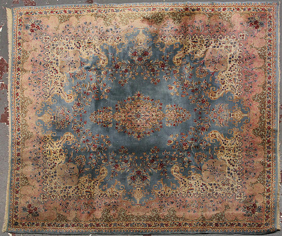 A Kerman carpet  size approximately 8ft. 1in. x 9ft. 7in.