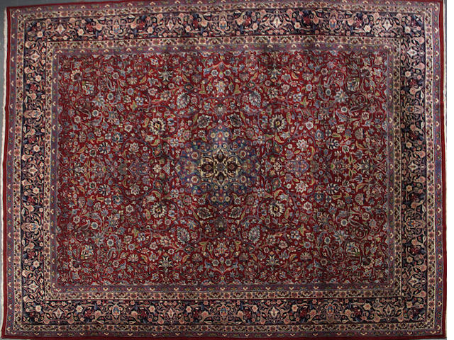 A Kerman carpet  size approximately 9ft. 6in. x 12ft. 6in.