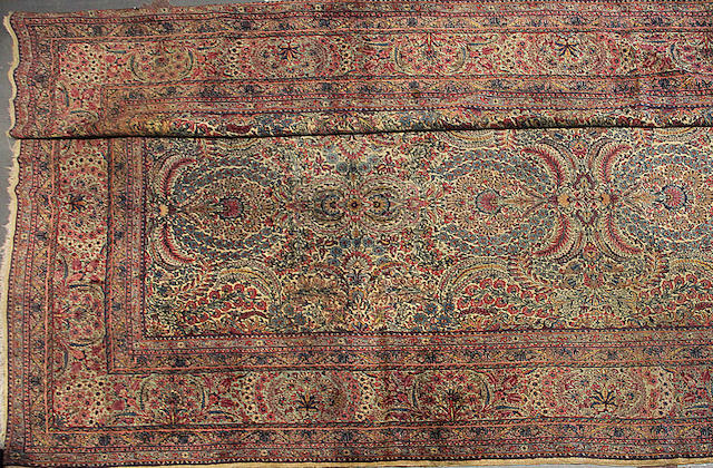 A Kerman carpet size approximately 13ft. 3in. x 19ft. 3in.