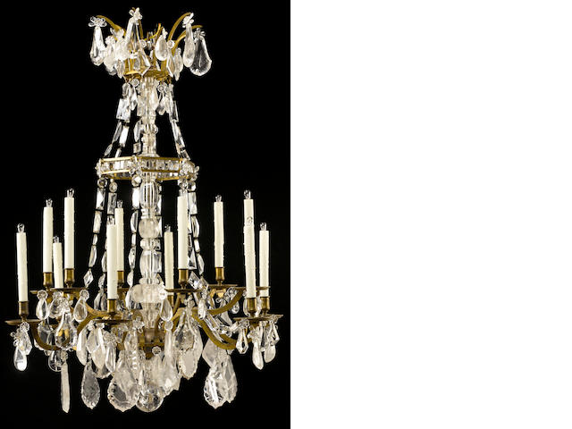 A fine Louis XVI gilt bronze and rock crystal twelve light chandelier fourth quarter 18th century