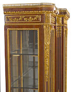 A fine Louis XVI style gilt bronze mounted mahogany triple vitrine cabinet Guillaume Grohé fourth quarter 19th century