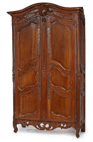 A Louis XV  fruitwood and walnut armoire  third quarter 18th century