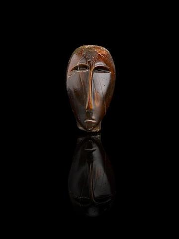 A magnificent and important Okvik Eskimo ivory head
