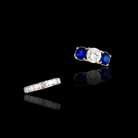 A diamond and sapphire ring and diamond band