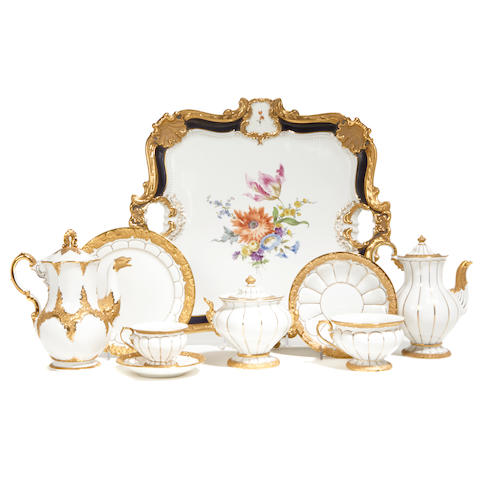 A Meissen gilt heightened porcelain part tea and coffee service