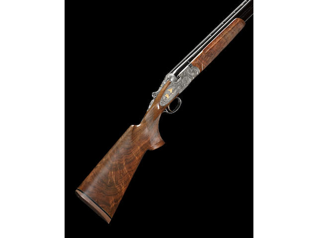 A cased, engraved and gold-inlaid 12 gauge Beretta SO-6 EELL Grade over/under sidelock shotgun
