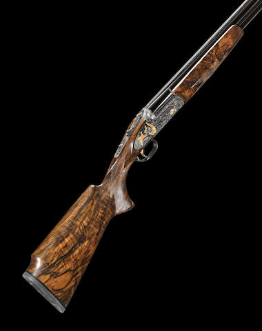 A 20 gauge engraved and gold-inlaid Perazzi Extra Gold Grade over/under shotgun