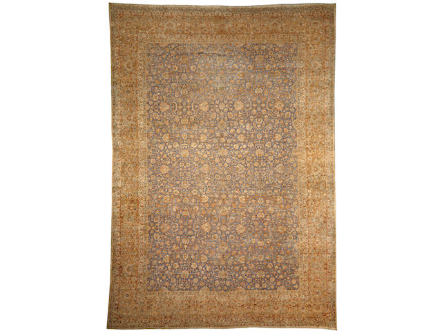 A Kerman carpet South Central Persia size approximately 12ft. 6in. x 18ft.