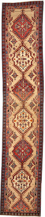 A Serab runner Northwest Persia size approximately 2ft. 10in. x 11ft. 10in.
