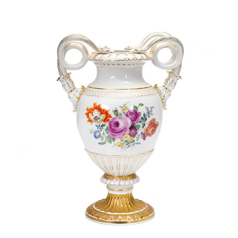 A Meissen floral decorated serpent handle vase