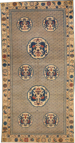 A Chinese carpet China size approximately 8ft. 8in. x 17ft.