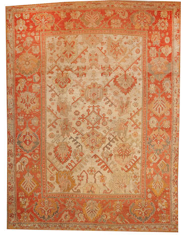 An Oushak carpet West Anatolia size approximately 8ft. 9in. x 11ft. 7in.