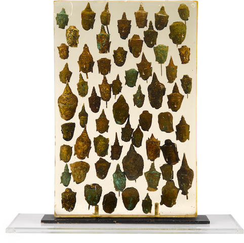 ARMAN (1928-2005) X-Sagesses, 1966 incised 'Arman 66' (lower left)accumulation of 60 bronze Buddha heads encased in acrylic with steel and Plexiglas base18 x 12 x 3in. (45.7 x 30.5 x 7.6cm)