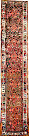A Malayer runner Central Persia size approximately 3ft. x 14ft. 7in.