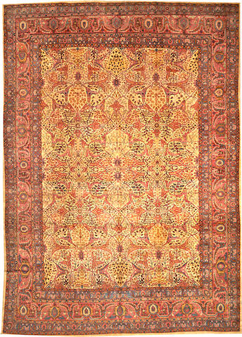 A Hereke carpet Turkey size approximately 9ft. 3in. x 13ft.