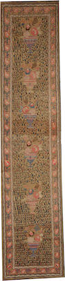 A Serab runner Northwest Persia size approximately 3ft. 5in. x 15ft. 5in.
