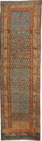 A Kurdish runner Northwest Persia size approximately 3ft. 9in. x 13ft. 1in.