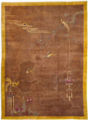 An Art Deco Chinese carpet China size approximately 9ft. 10in. x 13ft. 5in.