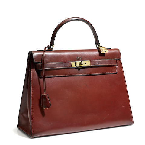 An Hermès burgundy leather Kelly handbag