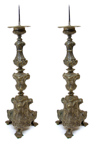 A pair of Baroque style silvered repousse brass pricket candlesticks late 19th century