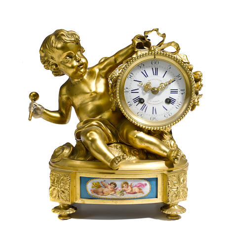 A Louis XVI style gilt bronze and porcelain mantel clock