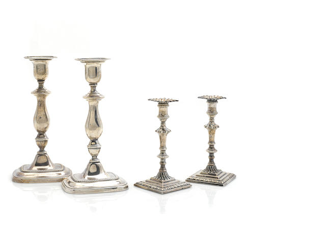 Two pairs of Edward VII / George V  weighted sterling silver  candlesticks by various makers, Sheffield,  1909-1910 & 1918