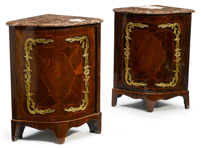 A pair of Louis XV style gilt bronze mounted inlaid walnut encoignures incorporating antique and later elements