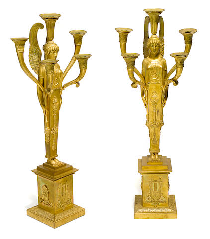 A pair of Empire gilt bronze five light figural candelabra first quarter 19th century