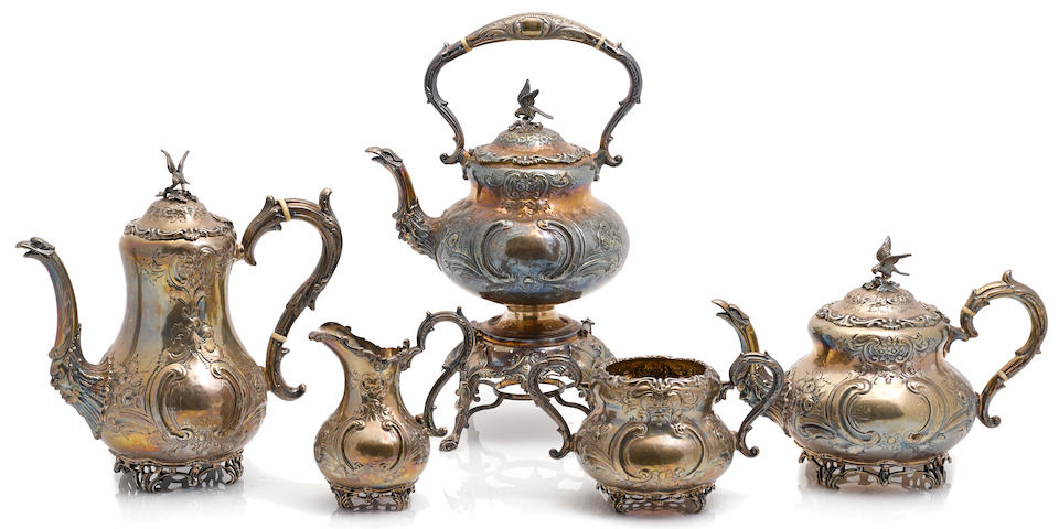 An assembled George V sterling silver five piece tea and coffee service by Martin, Hall & Co., Sheffield,  the kettle-on-stand 1904; the rest of the set 1926