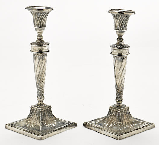 A pair of George III sterling silver spirally-fluted candlesticks marked TD, Sheffield, 1782