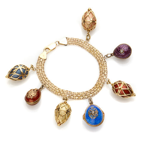 An enamel, diamond and 14k gold charm bracelet