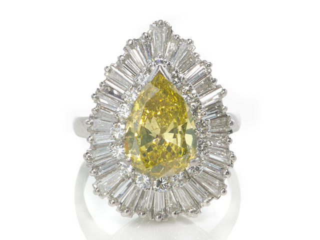 An irradiated colored diamond and diamond ballerina ring