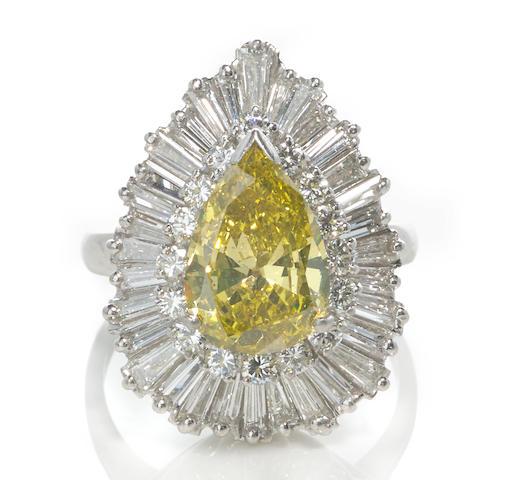 An irradiated colored diamond and diamond ballerina ring