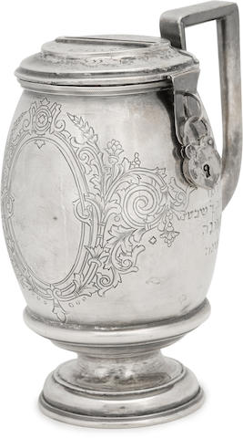 A Continental silver Tzedakah box  Moscow, 1879 of barrel shape with an inscription in Yiddish.