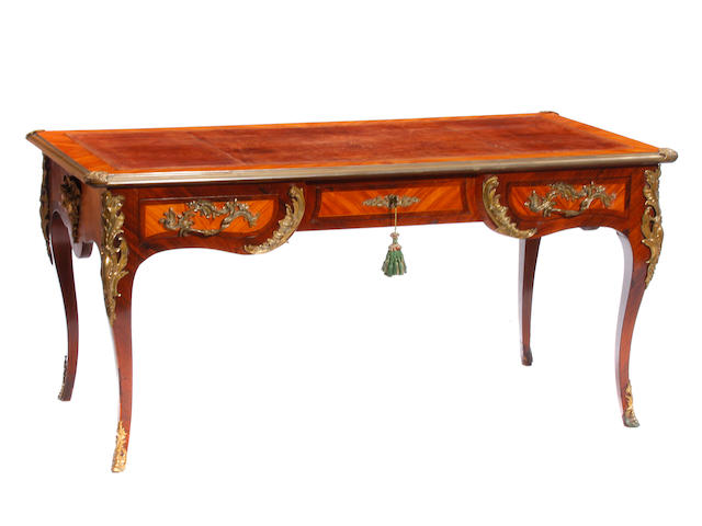 A Louis XV style gilt bronze mounted inlaid walnut bureau plat