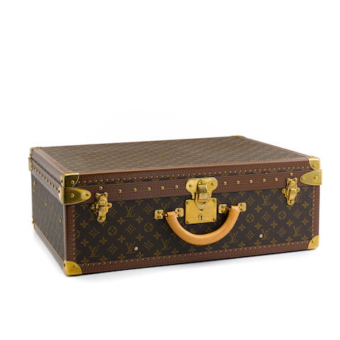 A Louis Vuitton monogram hard sided Alzer suitcase