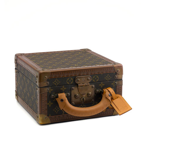 A Louis Vuitton small monogram train case