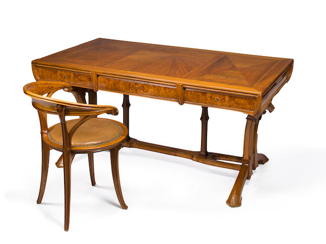 A Lucien Lévy-Dhurmer and Edouard Collet carved and burled walnut parquetry extension desk Designed for the Library of the Auguste Rateau residence, 10 bis, avenue Elysée Reclus, Paris, circa 1910-1912